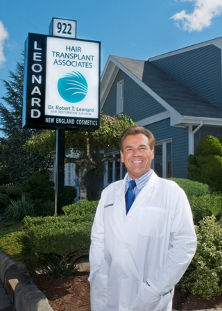 Dr._Leonard_with_sign_Web_V.jpg