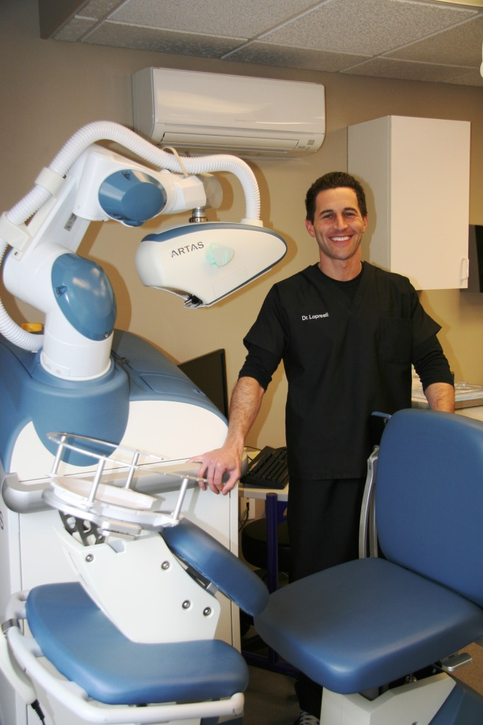 Dr. Lopresti with ARTAS Robotic System