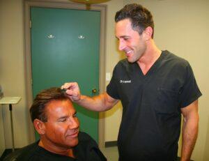 Dr. Lopresti examines Dr. Leonard